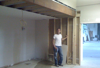 Steve standing in what will be our new kitchen